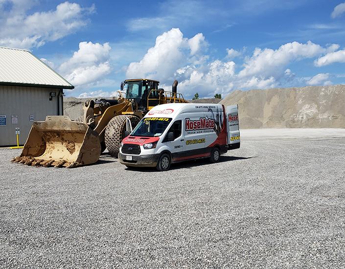 Hose Mate Hose and Hydraulics Van Next to Bulldozer